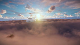 Cessna flying above clouds at sunset stock video