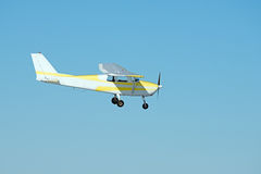 1960 CESSNA 172A. Flying against blue sky royalty free stock photo
