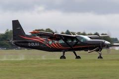 Cessna 208 G-DLAA macania Karawanowy puszek na pasie startowym Zdjęcie Royalty Free