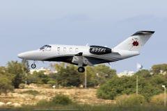 Cessna jet landing. Luqa, Malta June 11, 2017: A private Cessna 525 CitationJet M2 [N95KL] on short finals runway 31 Stock Photos