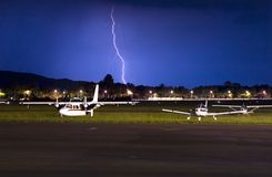 Cessna lighting. Small aircraft with lighting strike behind them Stock Photos