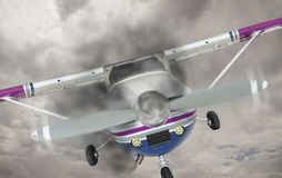 Cessna 172 With Smoke Coming From Engine Against Gray Sky Royalty Free Stock Image