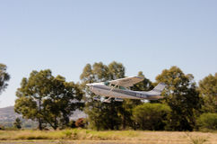 Cessna 172  airplane taking off from private airstrip Royalty Free Stock Image
