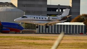 Cessna 560XL airplane landing on a runway stock photography