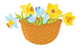 Cesta con las flores del resorte Fotos de archivo libres de regalías