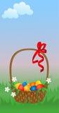 Cesta con los huevos de Pascua. Foto de archivo