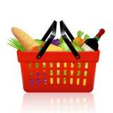 Cesta de compras con las tiendas de comestibles Fotografía de archivo