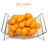 Cesta de fruto do metal em um fundo branco Foto de Stock