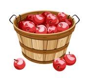 Cesta de madera con las manzanas rojas. ilustración del vector