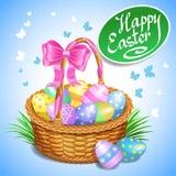 Cesta de Pascua con los huevos de Pascua pintados color Huevos de Pascua libre illustration