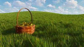 Cesta de Pascua con los huevos entre el primer de la hierba verde
