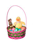 Cesta de Pascua con los huevos y el caramelo Imagenes de archivo