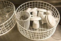 Cesta de uma máquina de lavar louça Fotografia de Stock