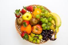 Cesta dos frutos no fundo branco Foto de Stock Royalty Free