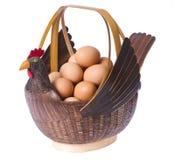 Cesta dos ovos no fundo branco Imagem de Stock Royalty Free