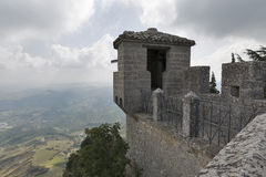 Cesta fortress watch tower in San Marino. Castello della Cesta or Cesta fortress watch tower overlooking San Marino from mountain Titano stock photo