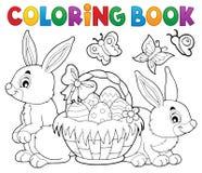 Cesta y conejos de Pascua del libro de colorear ilustración del vector
