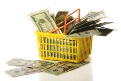 Cestino di acquisto di soldi Fotografia Stock