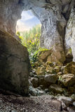 Cetatile cave sculpted by river in romanian mountains at sunrise Royalty Free Stock Images