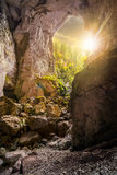 Cetatile cave sculpted by river in romanian mountains at sunset Royalty Free Stock Photos