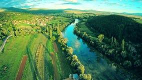 Cetina river near town Sinj in Croatia, aerial stock video footage