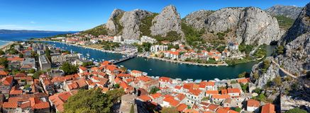 Cetina river Omis aerial panorama, Croatia. Panoramic image of town Omis and the Cetina river in Croatia. It is a town and port in the Dalmatia region. Its stock image