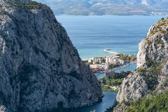 Cetina valley with Omis. View to Omis from the mountains with the river Cetina, the town, the adriatic sea and in the background the island of Brac with a clear royalty free stock photos