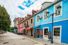Cetinje old town shops and buildings. CETINJE, MONTENEGRO - SEPTEMBER 20: This is one of the main shopping streets in Cetinje old town where you can see colorful Royalty Free Stock Photography
