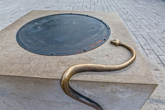 Cetinje snake on the well Stock Photos