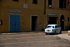 Cetona. Tuscany street city summer country road colors square car white shops Stock Photos