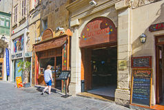 Cettina Cafe Luciano. VALLETTA, MALTA - SEPTEMBER 15, 2015: Cettina Cafe Luciano with old charming entrance portal, wood doors and vintage sign on a sunny day in Royalty Free Stock Images