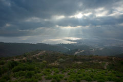 Ceuta under in the mist. Aerial view of Ceuta, spanish town in africa under the sun rays on a cloudy day stock photo