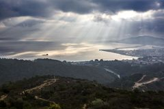 Ceuta from the Viewpoint of Isabel II under the mist. View of Ceuta from the Viewpoint of Isabel II. Spanish town in africa under the sun rays on a cloudy foggy stock photo