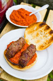 Cevapcici with ajvar in the grilled roll Stock Image