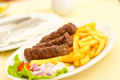 Cevapcici with chips Royalty Free Stock Photos