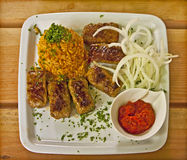 Cevapcici dish with peper sauce, onion and tomato  Stock Photography