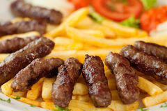 Cevapcici meal. Traditional Bosnian meal food cevapcici or cevapi Stock Photo
