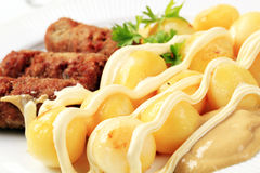 Cevapcici with potatoes Royalty Free Stock Images