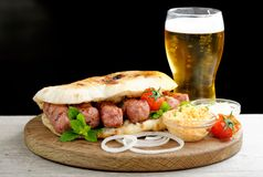 Cevapcici, a small skinless sausage cooked on the barbecue Stock Photos