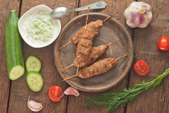 Cevapcici with tzatziki. The traditional Balkan dish Stock Photo