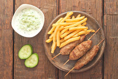 Cevapcici with tzatziki. The traditional Balkan dish Stock Photography