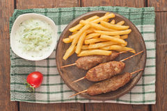 Cevapcici with tzatziki. The traditional Balkan dish Royalty Free Stock Photo