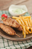 Cevapcici with tzatziki. The traditional Balkan dish Stock Image