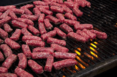 Cevapi. Grilling mini sausages - cevapi - on the charcoal Stock Photography