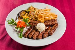 Cevapi. Whit french fries and grilled vegetables Stock Photography