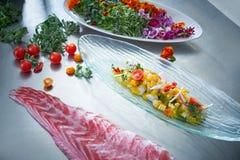 Ceviche dish preparation in restaurant kitchen Stock Image