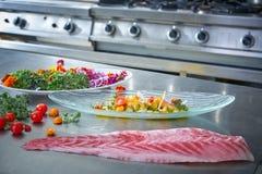 Ceviche dish preparation in restaurant kitchen Stock Photography