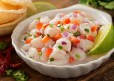 Ceviche. A freshly made scallop ceviche with red onion, cilantro, red pepper, lime, and serrano pepper Stock Images