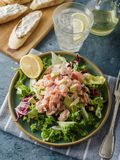 Ceviche is a traditional dish from Peru. Salmon marinated in lemon with fresh lettuce, avocado and onions. Peruvian food stock images