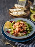 Ceviche is a traditional dish from Peru. Salmon marinated in lemon with fresh lettuce, avocado and onions. Peruvian food royalty free stock photography